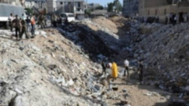 Rebellen in Syrien hinterlassen Massengrab